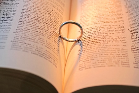 love proof: Ring on dictionary with shadow in heart shape Stock Photo