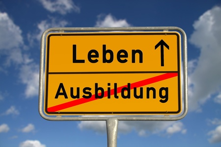 live work city: German road sign apprenticeship and life with blue sky and white clouds Stock Photo