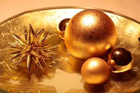 Bowl with golden Christmas decoration  star and Christms balls Stock Photo - 12638255