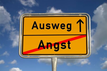 cramping: German road sign fear and  way out with blue sky and white clouds Stock Photo