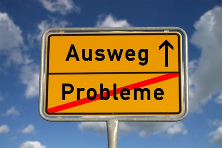 way out: German road sign problems and  way out with blue sky and white clouds Stock Photo