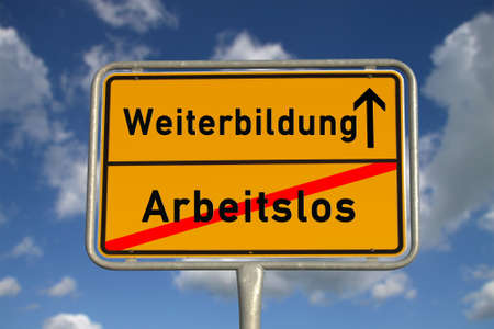 retraining: German school sign  unemployed  and further education with blue sky and white clouds Stock Photo