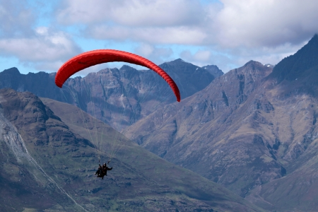 Paraglider in the mountains at Bobs Peak, Queentown, Otago, South island,  New Zealand Stock Photo