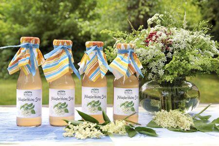 Elderflower syrup in the garden in summer photo