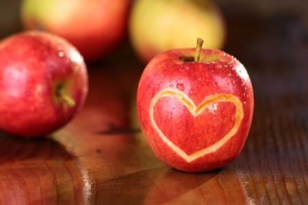 Apple heart on a wet table in the sun photo