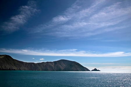 Sea coast with blue sky near Picton, New Zealand photo