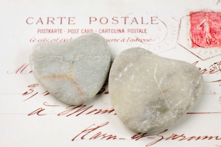 Two light stone hearts with old French  postcard Stock Photo - 14736124