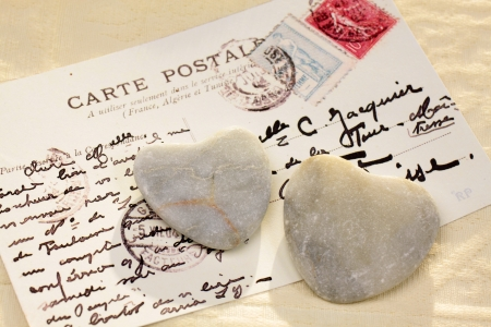 love proof: Two dark stone hearts with old French  postcard Editorial