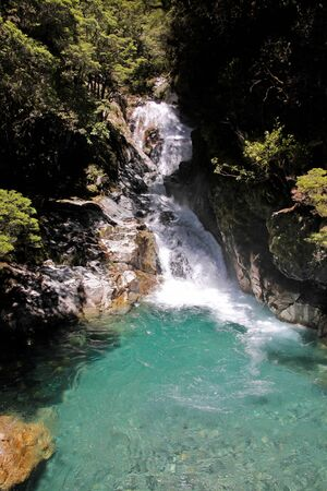 fiordland: Waterfall at the Milford Road, Southland, South island,  New Zealand