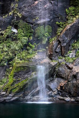 anau: Small water fall in the Milford Sound, Southland, South island,  New Zealand Stock Photo