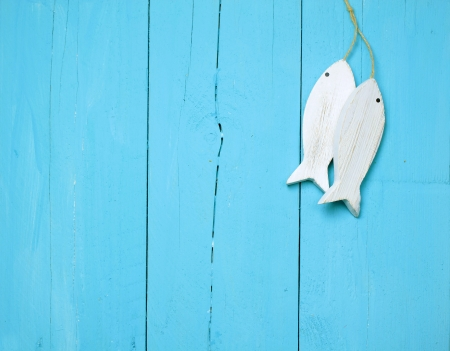 huts: Maritime decorations on a bright blue wooden wall