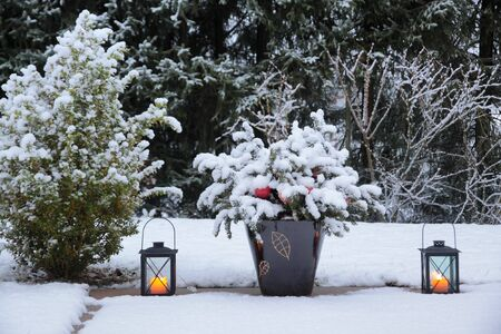 Lanterns with candles on the terrace in the snow photo