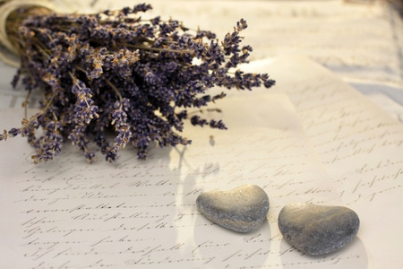 love proof: Stone hearts with old letter and lavender Stock Photo