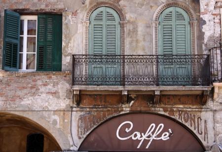 flaking: Old cafe on Piazza delle Erbe in Verona, Veneto, Italy