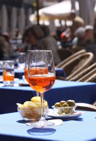 Aperol glasses at an outdoor cafe in Verona Stock Photo - 17317678