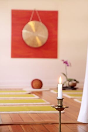 Gong: Large Gong, candle and orchid decoration in a yoga room