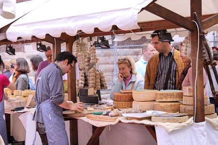 regionally: Market  stall with cheese in the old town of Verona, Veneto, Italy