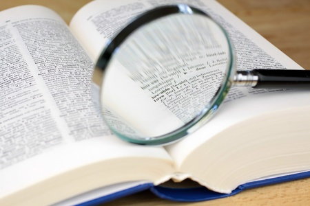 love proof: Magnifying glass on a English-German dictionary the word Love Stock Photo