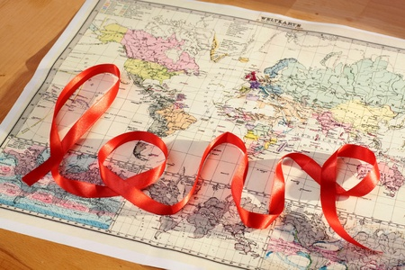 love proof: Red lettering love over historic world map Stock Photo