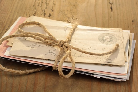 bundle of letters: Bundle of letters tied with a cord on the old wooden table Editorial