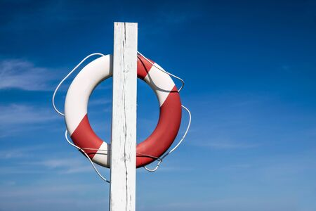 Lifebuoy in front of blue sky at the coast of Bornholm, Denmark photo