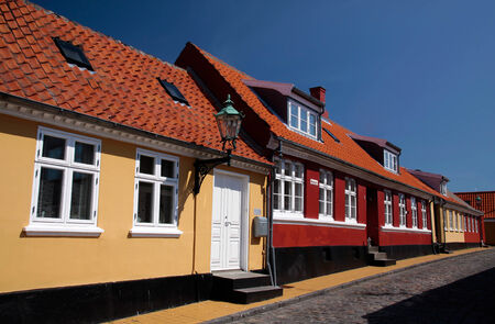 dwell house: Yellow and red houses in Roenne on Bornholm Stock Photo