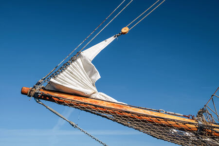 bowsprit: Bowsprit and gathered sail of a large sailing ship in Amaliehaven in Copenhagen, Denmark