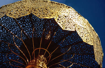 Golden umbrella in the  Doi Suthep monastery near Chiang Mai, Thailand photo