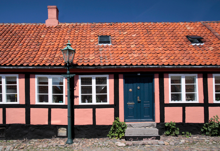 dwell house: Pink half-timbered house in Roenne on Bornholm, Denmark