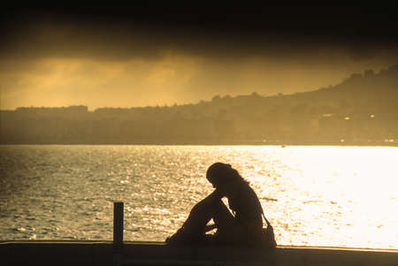 Young woman at sunset at the Promenade des Anglais in Nice, Cote Azur, France photo