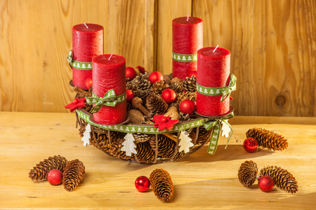 Advent wreath with red candles in country style