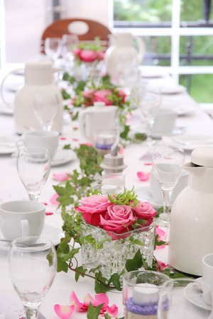 tea ceremony: Solemnly laid table for a wedding with white and pink Stock Photo