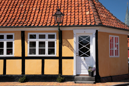 dwell house: Yellow half-timbered house in Roenne on Bornholm, Denmark