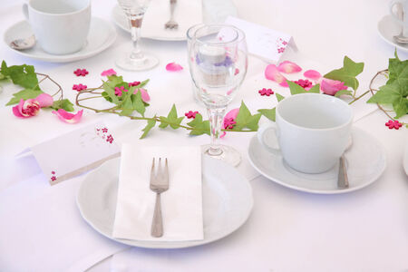 Solemnly laid table for a wedding with white and pink Stok Fotoğraf