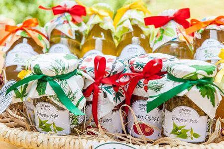 jams: Basket with homemade chutneys and jams traditionally packed