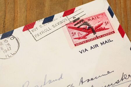 old envelope: Close up of old airmail letter from the US on wooden desk Stock Photo