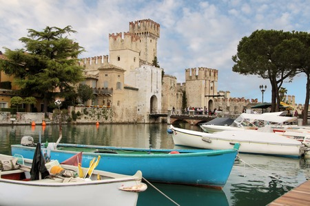 sirmione: Port and fortress of Sirmione on Lake Garda, Region in Brescia, Lombardy, Italy