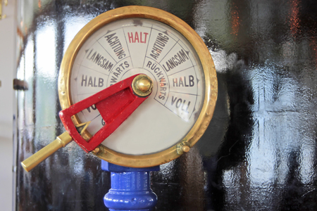 wheelhouse: Close up of an old fashioned speed indicator and telegraph used to convey speed control orders from a ship`s bridge or wheelhouse to its engine room; on historic paddle steamer Goethe on the Rhine, Germany