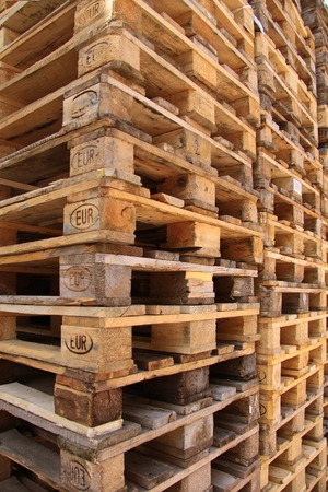 Stacked Euro pallets obliquely from the side