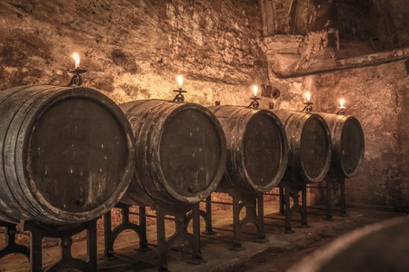 casks: Old wine barrels in winecellar with candles