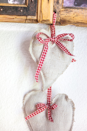 mountain hut: Fabric Heart as rustic decoration in a mountain hut Stock Photo