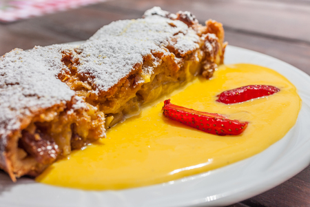 vespers: Apple strudel with vanilla sauce on a mountain hut in South Tyrol, Italy Stock Photo