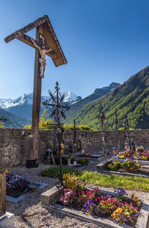 campo: Old cemetery cross in the cemetery  in Campo Tures, South Tyrol, Italy Stock Photo