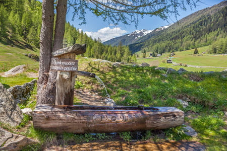 Drinking fountain at the Holy Ghost Church in Kasern, Rear Ahrntal, South Tyrol, Italy Stock Photo