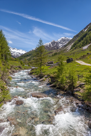 Stream near the Church of the Holy Ghost in the rear Ahrntal, South Tyrol, Italy