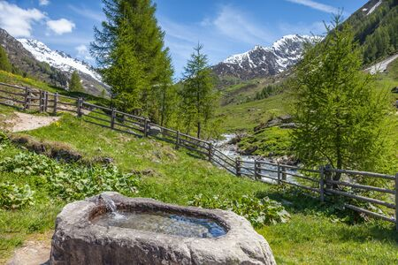 Fountain at the Holy Spirit Church in Kasern, Rear Ahrntal, South Tyrol, Italy