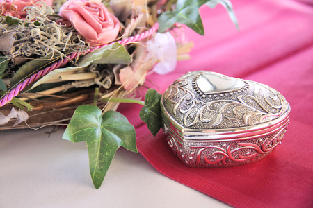 Noble box in heart shape on a wedding table Stock Photo