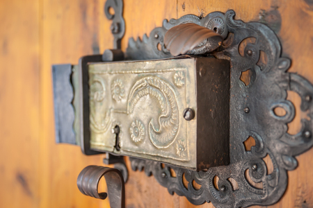 Church portal with old door lock at the parish church of St. Peter in Villnoesstal, South Tyrol, Italy 版權商用圖片