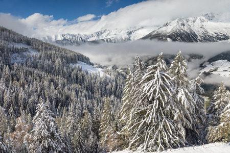 View from the Klausberg into the snow-covered Valle Aurina, South Tyrol, Italy