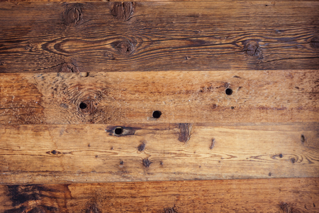 Old, weathered wooden board on a farm in South Tyrol, Italy Stock Photo